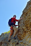 Climber man with backpack Stock Images