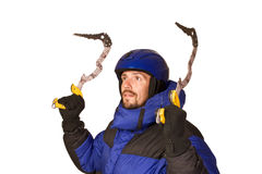 Climber man with chisel in hands up Royalty Free Stock Photos