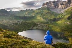 Climber man enjoying mountain view at sunset Royalty Free Stock Images