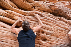 Climber man free climbing on rock Stock Photo