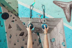 Climber man gripping handhold Stock Images