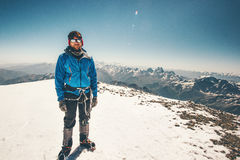 Climber Man reached Elbrus mountain east summit. Travel Lifestyle success concept adventure active vacations outdoor mountaineering sport aerial view Greater Stock Photos