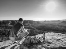 Free Climber Man Sit On Rock, Prepare For Eating Snack During Rest Royalty Free Stock Photography - 159807637