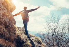 Climber man stay on the edge of deep with view on the mountain v Stock Images
