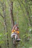 Climber man in adventure park Royalty Free Stock Photo