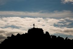 Climber on mountain top in Snowdonia Wales. 