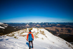 Climber in the mountains in winter. Royalty Free Stock Photo
