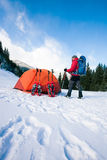 Climber near the tent with snowshoes. Royalty Free Stock Photo