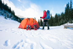 Climber near the tent with snowshoes. Royalty Free Stock Photography