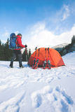 Climber near the tent with snowshoes. Stock Photography