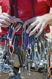 Climber organizing equipment. Stock Photo