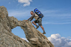 Climber over the clouds Stock Photography
