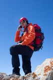 Climber on the phone Royalty Free Stock Photography
