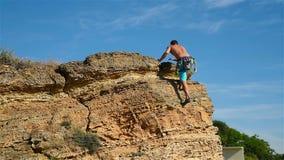 Climber Raising Hands stock video