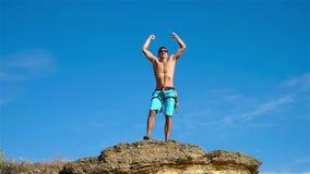 Climber Raising Hands stock footage