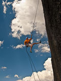Climber rappelling. Royalty Free Stock Images