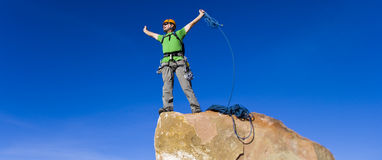 Climber rappelling from the summit. Stock Photography