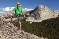 Climber rappelling from the summit. Stock Image
