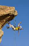 Climber rappelling from the summit. Royalty Free Stock Photos