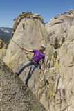 Climber rappelling from the summit. Stock Images