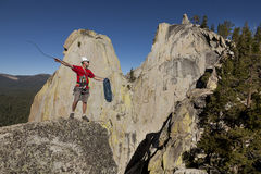 Climber rappelling from the summit. Royalty Free Stock Images