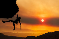 Climber rappells the edge. Royalty Free Stock Photo