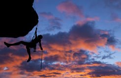 Climber rappells the edge. Royalty Free Stock Photos