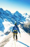 Climber  reaches the summit of mountain peak. Success, freedom a Royalty Free Stock Photos