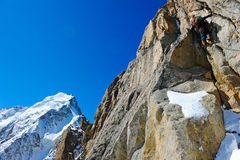 Climber reaching the summit of mountain Royalty Free Stock Image