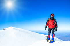 A climber reaching the summit of the mountain Stock Photos