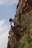 Climber on a rock Stock Image