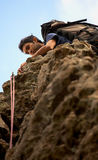 Climber on a rock Royalty Free Stock Image