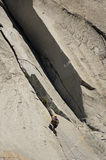 Climber on rock face
