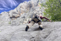 Climber on the rock. Freestyle Climber on the rock wall in the National Park Paklenica, Croatia Royalty Free Stock Photos