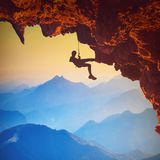 Climber on a rocky cliff stock images
