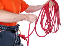 Climber with rope in hands. On white background Royalty Free Stock Photography
