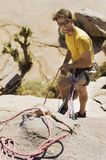 Climber with Ropes on Cliff Royalty Free Stock Image