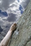 Climber's hand with quick-draws Stock Images