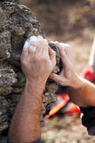 Climber's hands. Holding rock Stock Photo