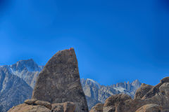 Climber on sharks fin arete route with mount whitney Royalty Free Stock Image