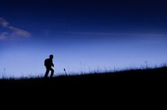 Climber silhouette on the grassland.  Royalty Free Stock Photography