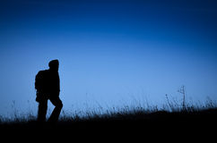 Climber silhouette on the grassland Stock Image