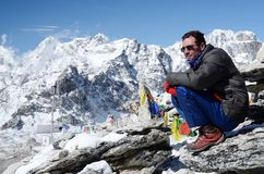 Climber sitting at foot of Kala Patthar mountain,Nepal stock photography