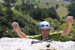 Climber six. A happy climber who arrives at the summit Stock Image