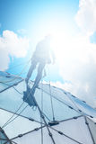 Climber on a skyscraper Stock Image