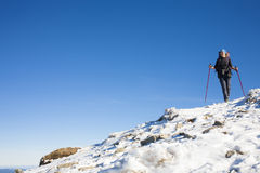 Climber is on the slope. Royalty Free Stock Photo