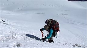 Climber on snow alpinist route stock footage