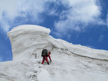 Climber on snow alpinist route Royalty Free Stock Image