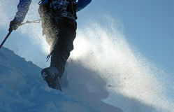 Climber in a snowstorm stock image