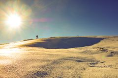 Climber on snowy Altissimo crest in Italy. Image of climber on snowy Altissimo crest in Italy royalty free stock images